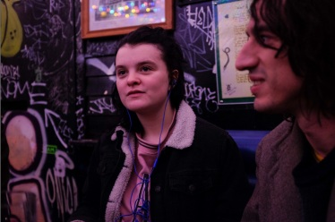 Photographer Holly Whitaker with Lias Saoudi listening to new Fat White Family tracks